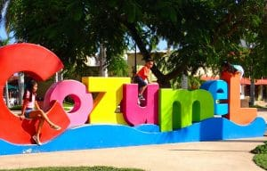 Cozumel Colorful sign with kids