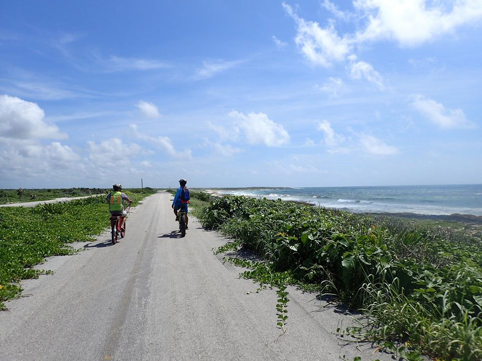 Riding bikes up the other side of island