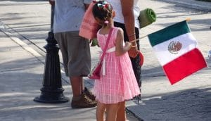 Young girl at Cozumel parade with MX flag