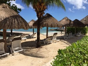 Lounge chairs and palapa umbrellas at Caribbean beach