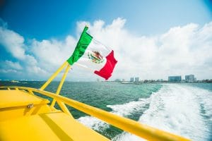 Yellow ferry boat rails and Mexican flag