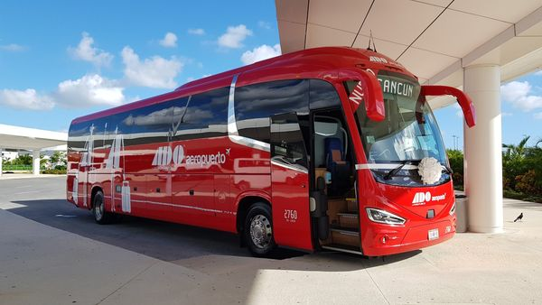 red commuter bus from ADO company in Mexico