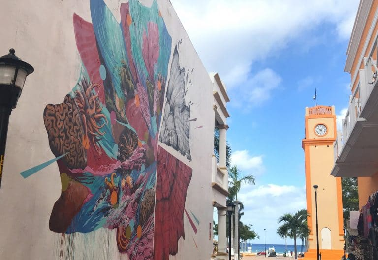 Downtown San Miguel plaza showing street mural and orange clock tower