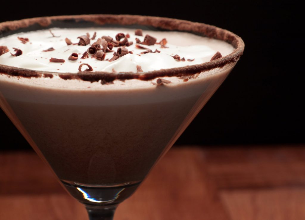 Fancy chocolate cocktail in cocoa rimmed martini glass.