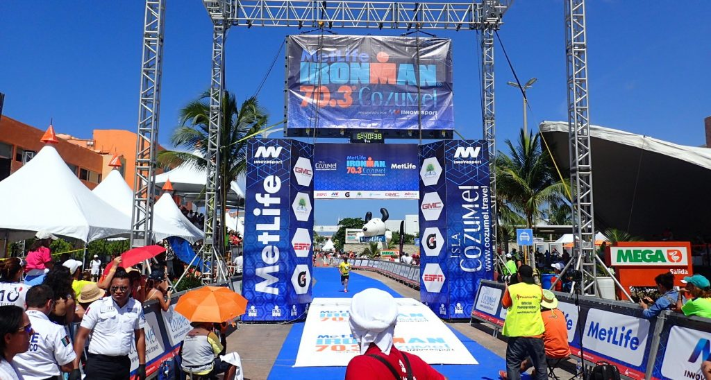 One of elite runners crossing the finish line of Cozumel Ironman 70.3 event.
