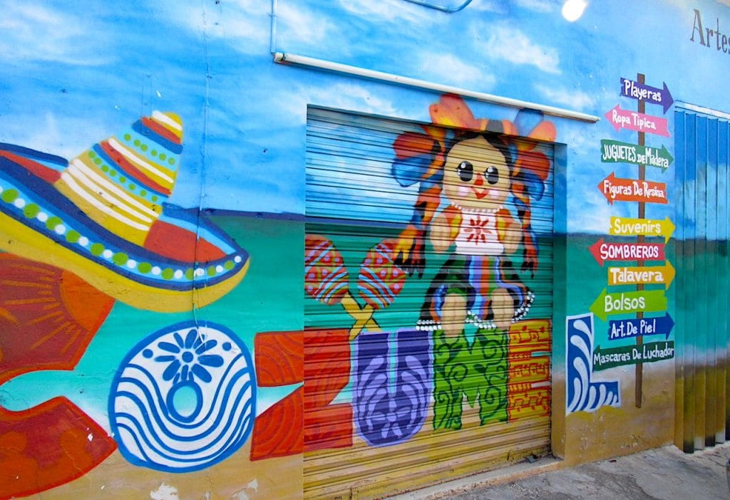 Blue and bright colored mural painted on artisan souvenir shop on Cozumel street.