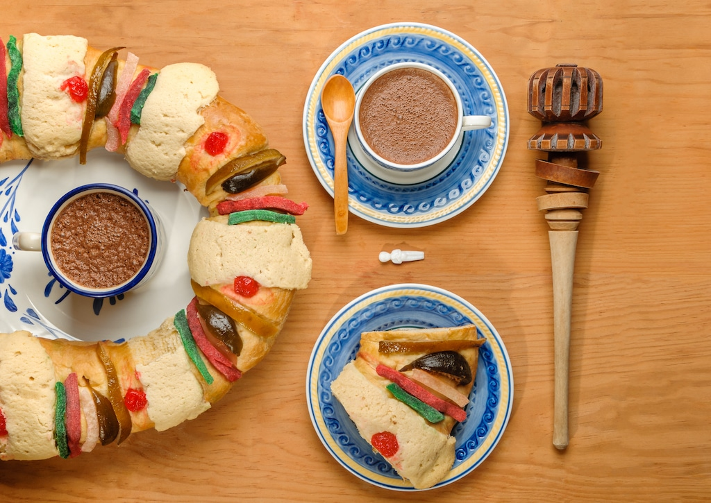 Rosca de Reyes cake with cup of hot chocolate. Rosca de Reyes is like an Epiphany cake in European versions of this holiday.