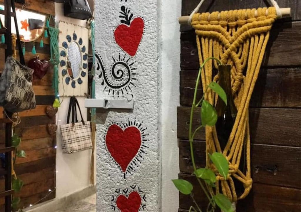 Interior of boutique store in Cozumel featuring glass hearts and macrame items.