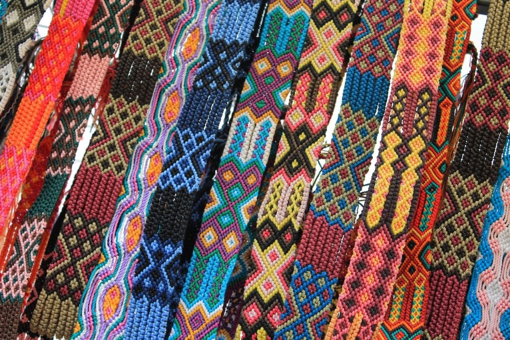 Colorful woven macrame belts from Mexico.