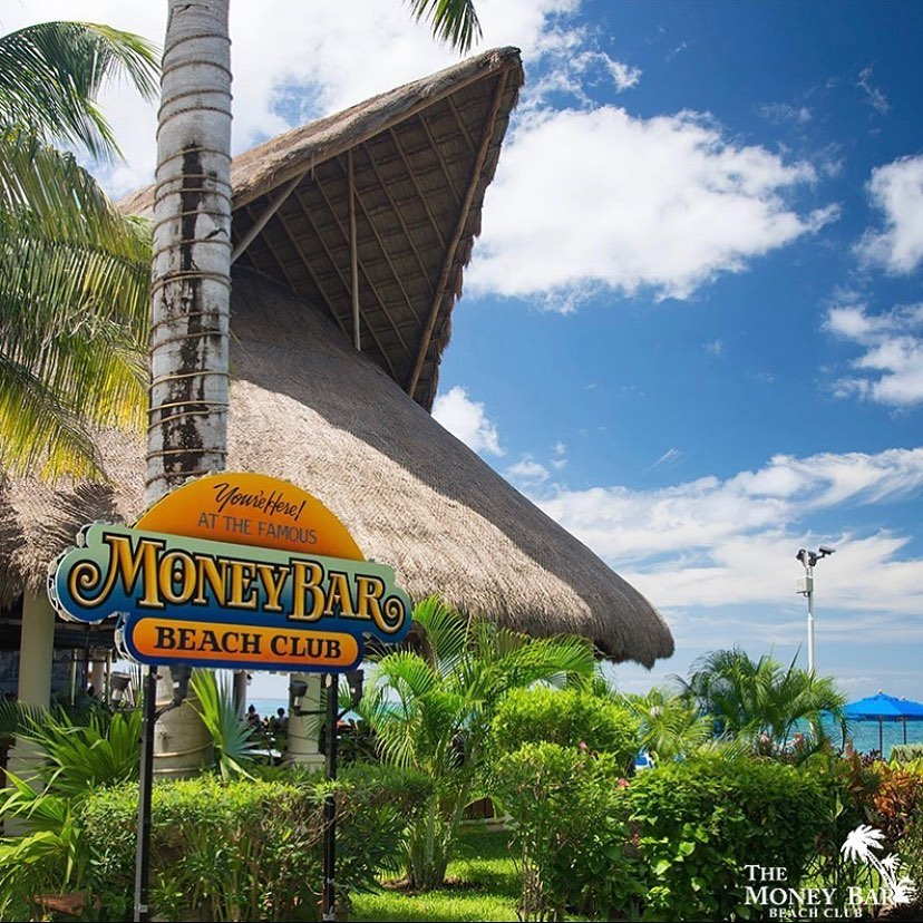 Money Bar promotional image of entrance to restaurant and ocean backdrop.