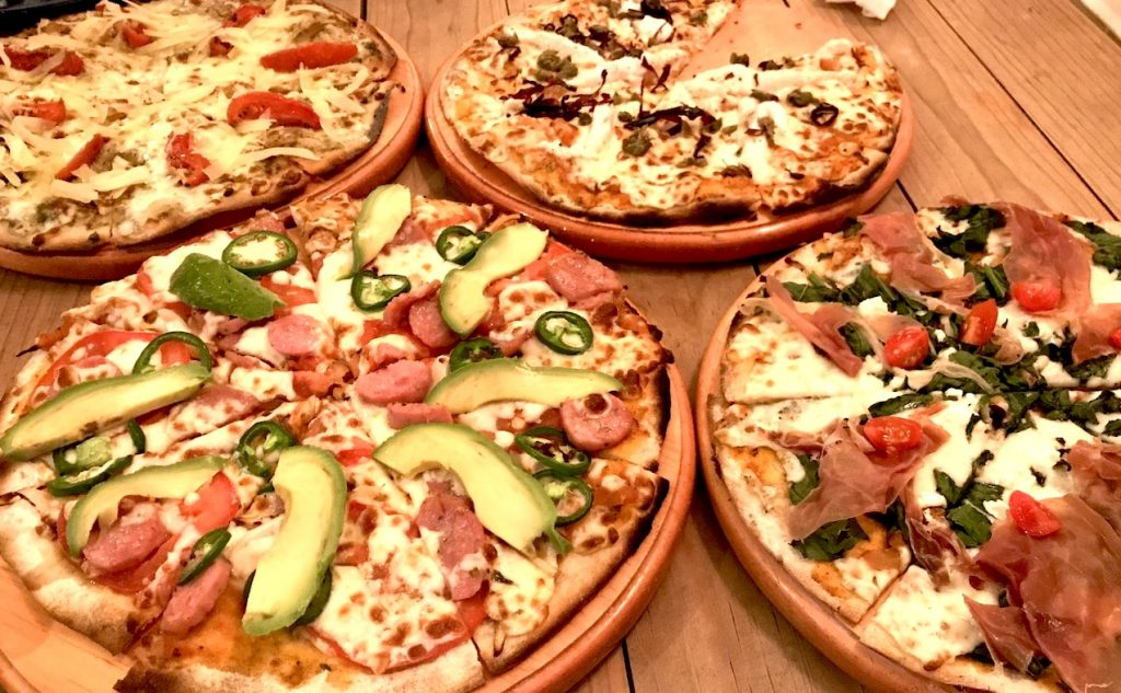 Assortment of pizzas from Punta Sur Cerveceria (brewery) in Cozumel.