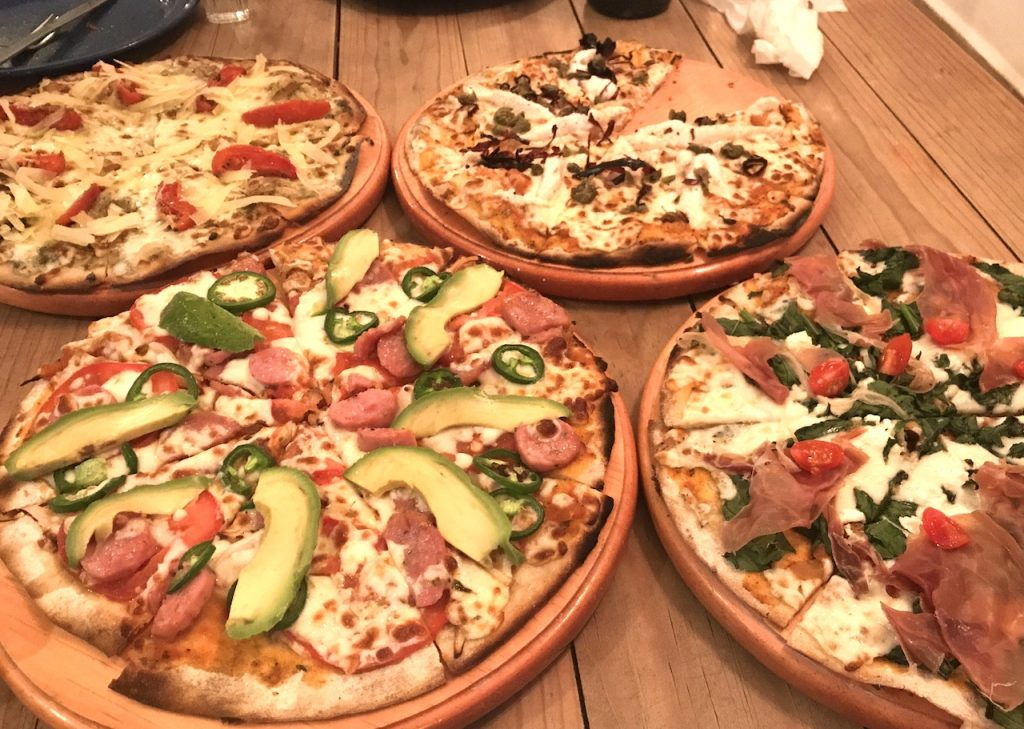 Assortment of fresh from the oven pizzas at Punta Sur Cerveseria in Cozumel.