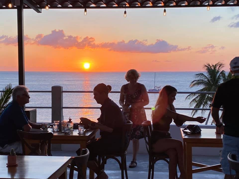 Rooftop bar and great ocean view backdrop from Sereno restaurant in Cozumel, MX.