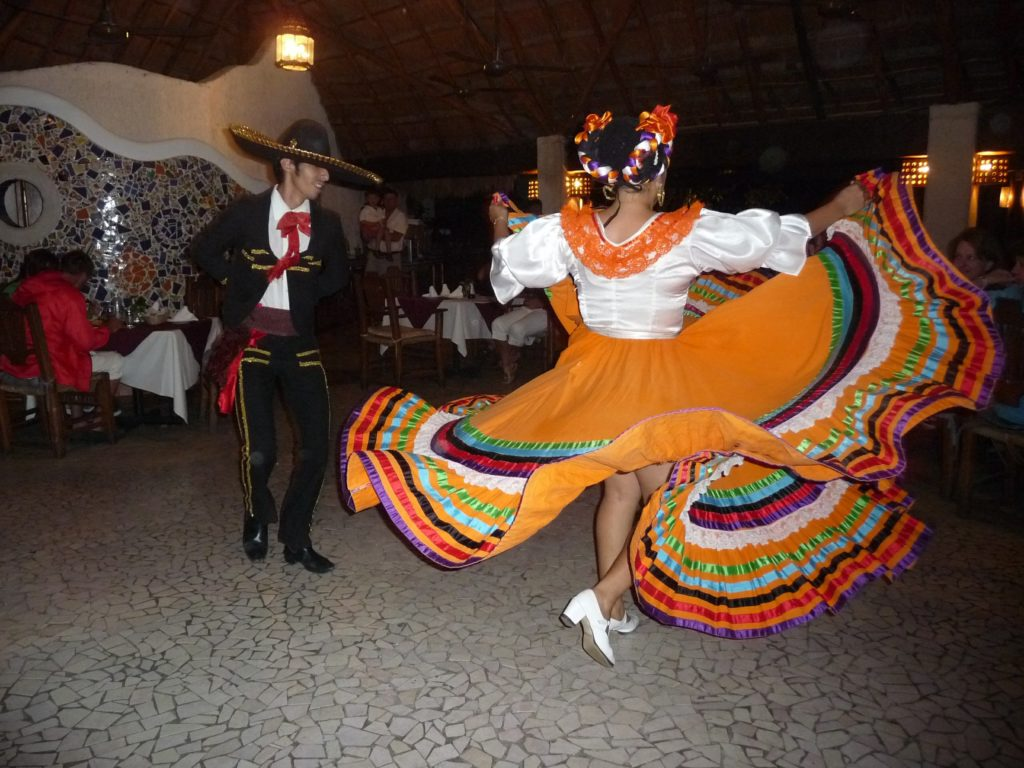 Festive Mexican dancers at a wedding in Cozumel Mexico.